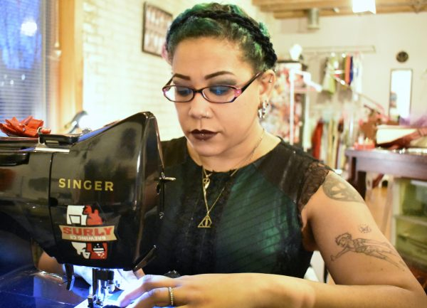 Samantha Rei at a sewing machine