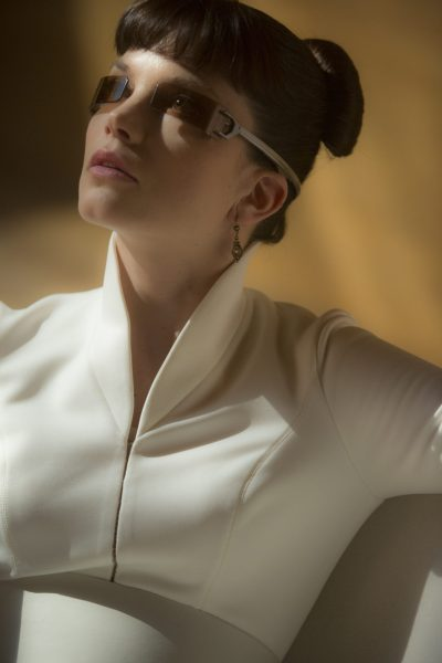 Profile of Luv (Sylvia Hoeks) wearing futuristic wraparound sunglasses.