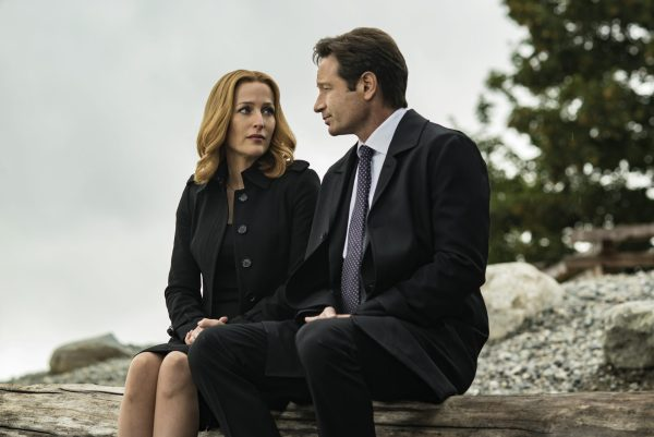 Scully and Mulder sitting side by side