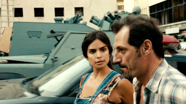 A still of main characters having a tense discussion in The Insult.