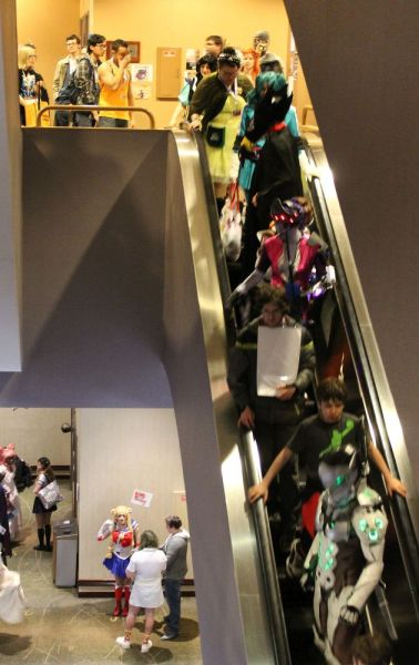 Convention attendees on the escalators