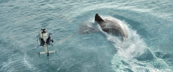 A helicopter hovers over the giant shark