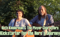 Beth Kinderman and Dave Stanger, holding guitars