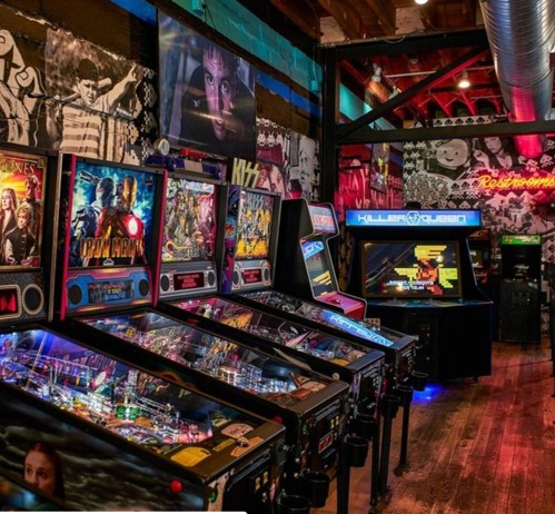 A row of pinball machines and other arcade games at Up-Down.