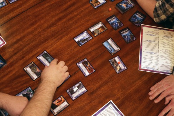 Cards are laid out on a table, demonstrating a combat phase in Seize the Imperium.