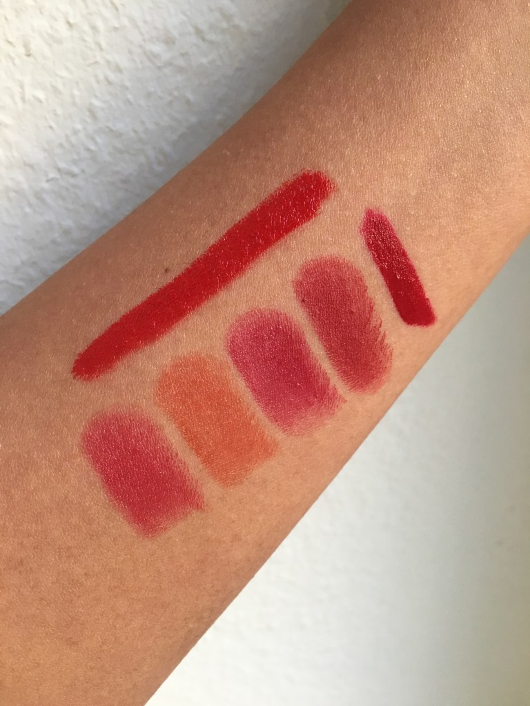 Top is el lethal red. Bottom left to right: Rouge Ecstasy 414, 405, 401, MAC Viva Glam I, Hourglass Icon.
