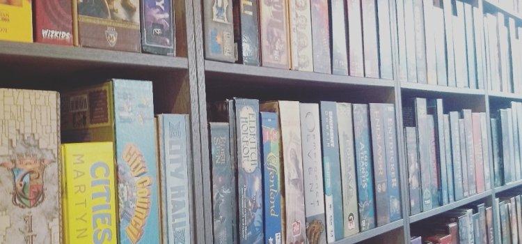 Bookshelves full of board games at the Ludorati cafe, Nottingham