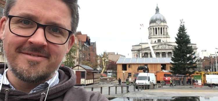 A picture of the Old Market Square in Nottingham with the Council House in the background and Jonathan in the foreground.