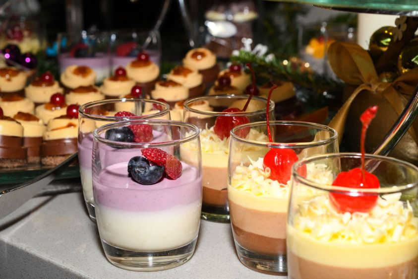 Various desserts in candy bar food buffet during hotel brunch, catering, cake pops, mousse, tarts