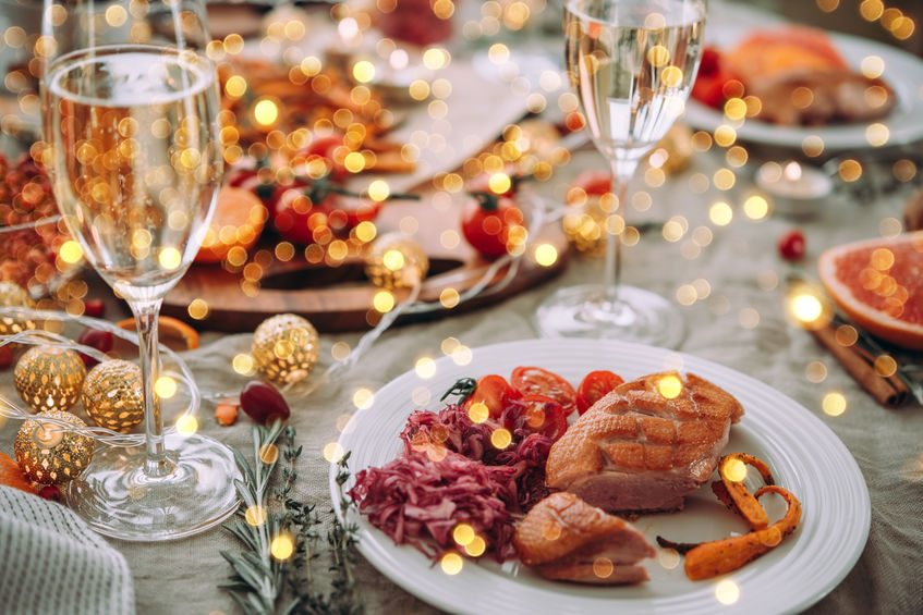 Roasted duck or turkey. Party table with glasses of champagne.