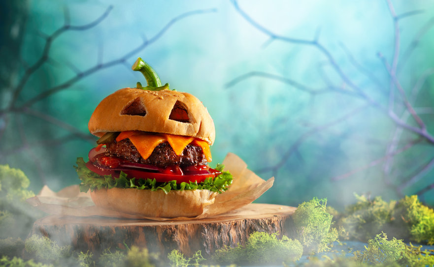Halloween party burger in shape of scary pumpkin