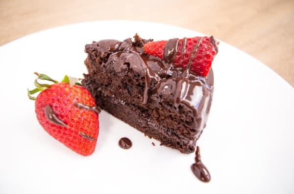 choc cake slice with strawberries