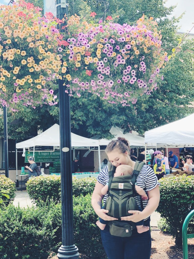 Guide and tips for how to baby wear, along with my experience with Ergobaby carriers during our trip to Newport, Oregon on the Oregon Coast. #babywearing #twinmom #babywearingmom #newborn #baby #babycarrier