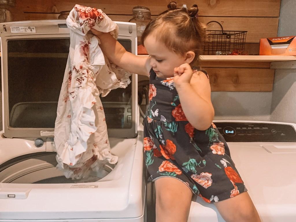 teaching toddlers life skills like laundry