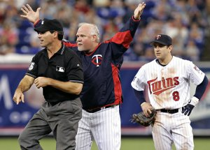 Gardy is on his way to an early shower in 2006 as NIck Punto looks on.