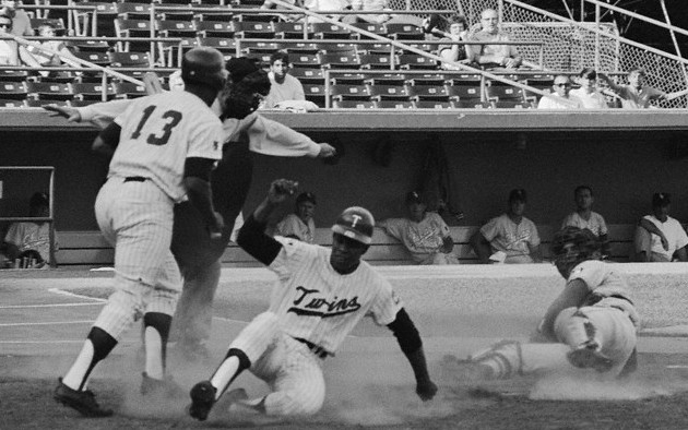 Shown here is Carew sliding past White Sox catcher Don Pavletich, the umpire is Bob Stewart, and the batter (number 13) is John Roseboro.