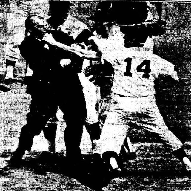 Sam Mele (14), incensed over Bill Valentine's decision at first base strikes a fighter's pose in the sixth inning og game one at Met Stadium July 18. Attempting to break up the melee are Rich Rollins (glasses), Twins third baseman and pitcher Jim Kaat. The incident cost Mele a $500 fine and a five-day suspension.