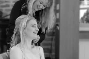 Laura styling hair for a wedding