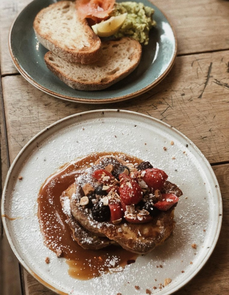 French toast topped with berries and covered in salted caramel sauce
