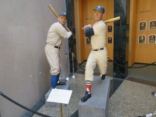 Babe Ruth and Ted Williams. These statues are carved of wood - no metal, leather or cloth.