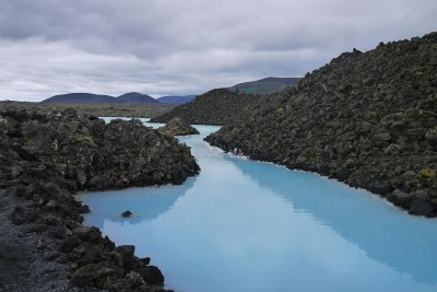 mineralized water of the blue lagoon contrasting with the lava field