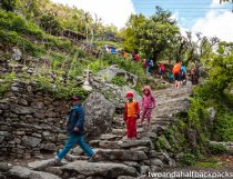 local Nepalis heading down and trekkers heading up above