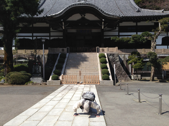 Mark bowing at one of the shrines.  Uh oh...... he is facing the wrong way.
