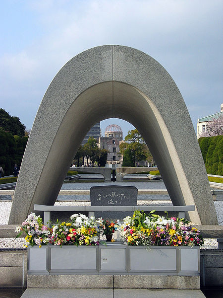 """The Memorial Cenotaph in Hiroshima Peace Memorial Park. The Cenotaph represents an """"empty tomb"""" or a monument erected in honor of the victims of the Hiroshima atom bomb.  The cenotaph carries the epitaph """"安らかに眠って下さい 過ちは 繰返しませぬから"""", which means """"please rest in peace, for [we/they] shall not repeat the error."""" In Japanese, the sentence's subject is omitted, thus it could be interpreted as either """"[we] shall not repeat the error"""" or as """"[they] shall not repeat the error"""". This was intended to memorialize the victims of Hiroshima without politicizing the issue, taking advantage of the fact that polite Japanese speech typically demands lexical ambiguity."""