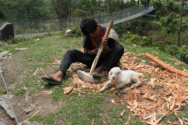 Woodcarver and his pet lamb.