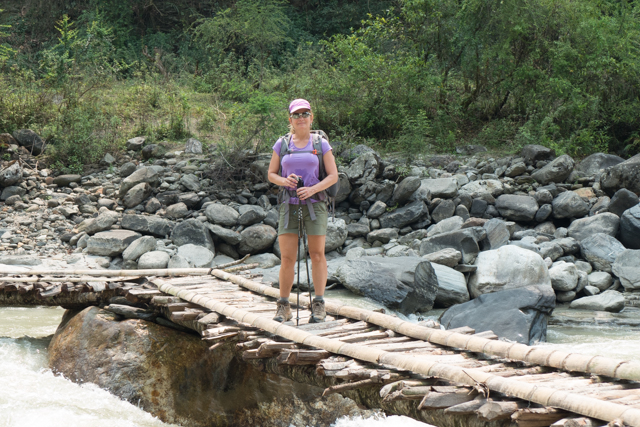 Shauna over a fast flowing river.