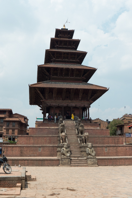 Bhaktapur is an ancient Newar town in the east corner of the Kathmandu Valley, Nepal, about eight miles from Kathmandu.   It has buildings that are 500 to 600 years old and contains the best preserved Palace courtyards and old city center in Nepal, and is listed as a World Heritage Site by UNESCO for its rich culture, temples, and wood, metal and stone artwork.