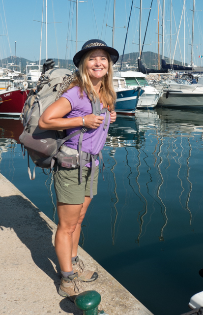About to travel to the Pyrenees to start our GR10 adventure.  With her pack and hiking gear, Shauna provides a striking contrast to the boats in the harbor.