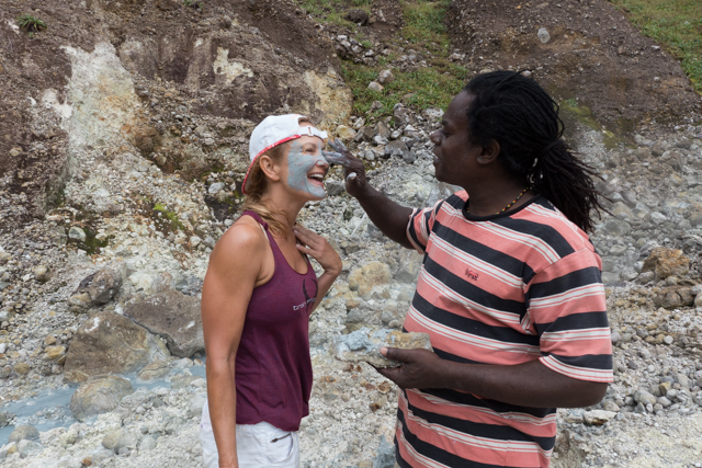 Sea Cat, our local guide (who does this hike about 100 times each year), applies a mud bath to Shauna's face.