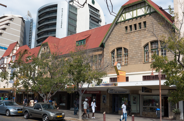 The old German architecture in downtown Windhoek juxtapositioned against newer office buildings.