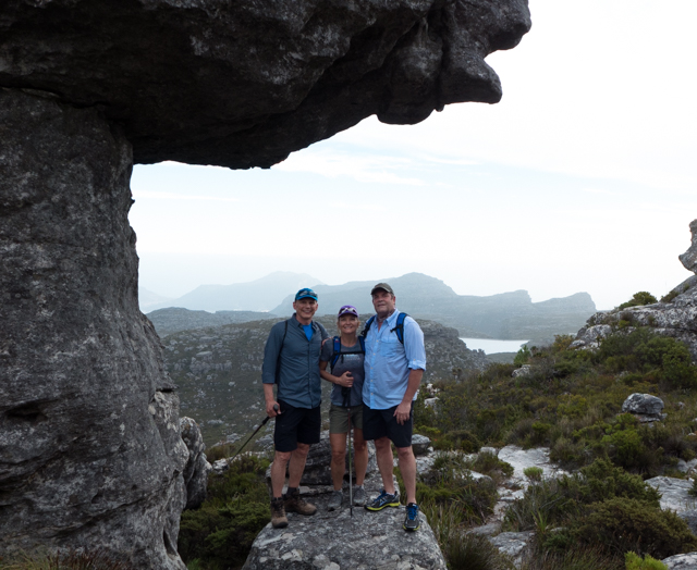 Mark, Will and Shauna standing in the shade of Camel Head Rock.