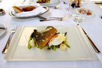 Ocean trout with asparagus, onions and poached egg.