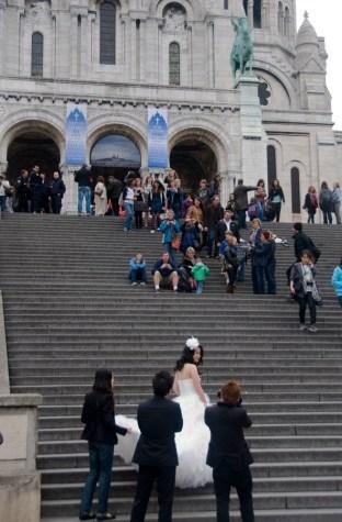 Bride on the steps of the Sacre Coeur, Montmartre Paris