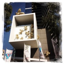 Golden bees at home on a high-rise