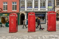 Traditional red phone booths on the Royal Mile