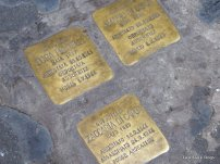 Small, cobblestone-sized memorials, placed in memory of the individual victims arrested or sent to concentrations camps during WWII when the Nazis occupied Rome