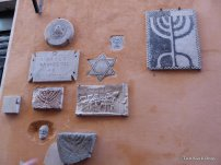 Stone reliefs mounted on a wall in Via Reginella alley in Rome's Jewish Ghetto
