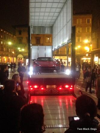 A Lamborghini being offloaded in Piazza Maggiore