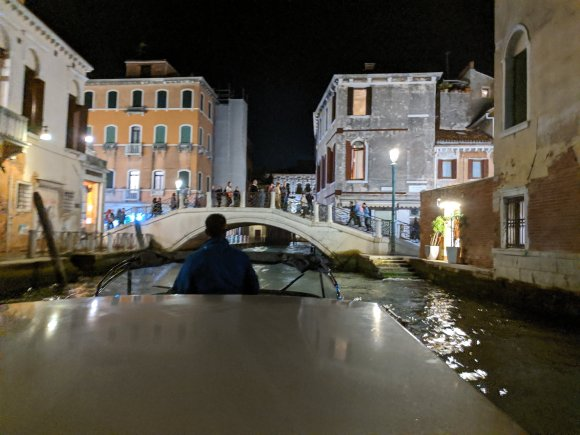 View of the Grand Canal from a water taxi at night