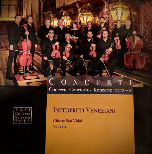 Orchestra of violin players who play Vivaldi music