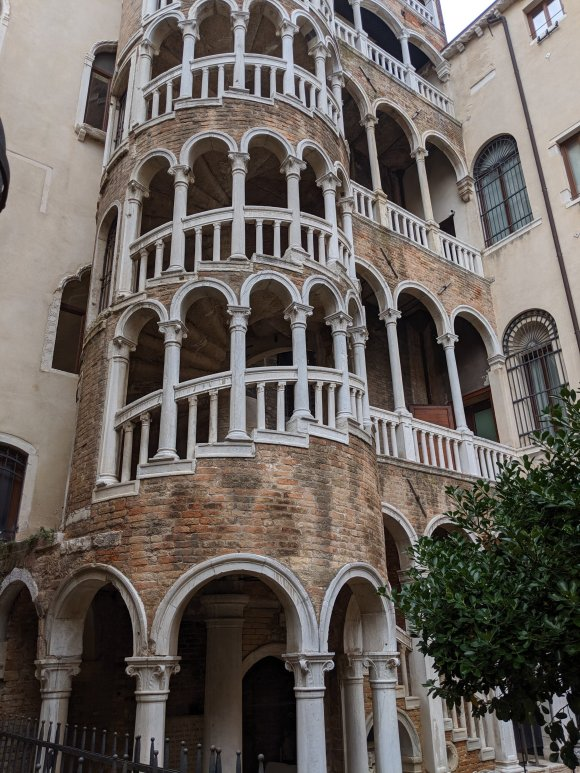 Exterior spiral staircase on multistory ancient home