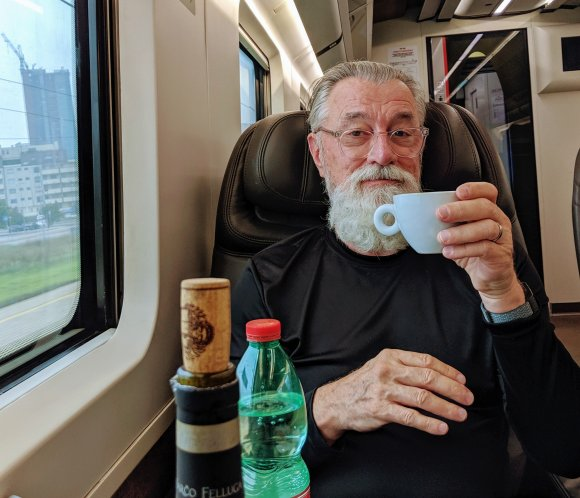 Adriel drinking capucchino on a delightful train ride to Florence