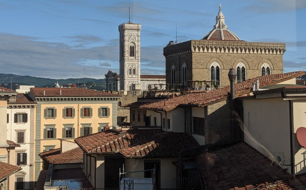 Sunny view of Florence, Italy rooftops on All Saints Day