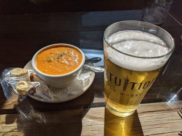 Cup of grouper bisque and a pale yellow beer at the Turtle Shack Cafe - Flagler Beach