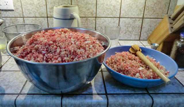 two bowls full of light-pink pomegranate seeds