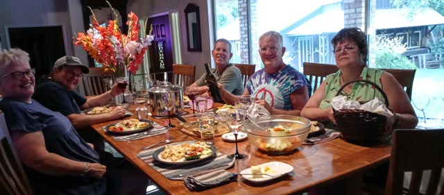 people preparing to eat at the table